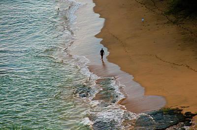 A Man Walks On A Beach Along The Napali Art Print by Karen Kasmauski
