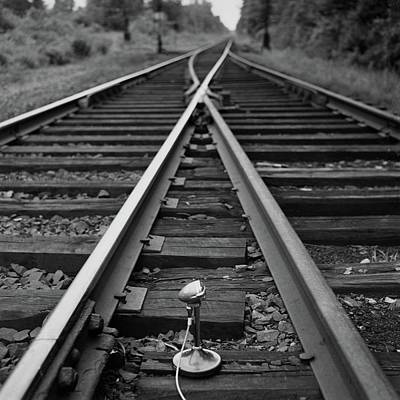 A Microphone Placed In Between Railroad Tracks Art Print by Richard Rutledge