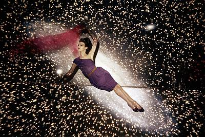 1960 Photograph - A Model Against A Galaxy Backdrop by John Rawlings