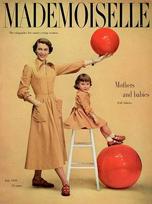 Photograph - A Model And A Girl With Red Balls Wearing Joan by Herman Landshoff