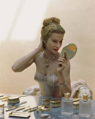 Fashion Jewelry Photograph - A Model At A Dressing Table by John Rawlings