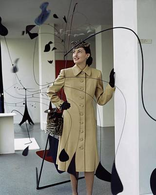Museum Of Modern Arts Photograph - A Model Behind Calder Mobiles At The Museum by John Rawlings