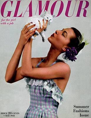 Fashion Photograph - A Model Holding A Kitten by Gjon Mili