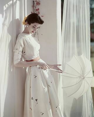 Umbrella Photograph - A Model Holding A Parasol by Horst P. Horst