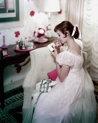 Photograph - A Model In A Gown Sitting On An Armchair by Sante Forlano