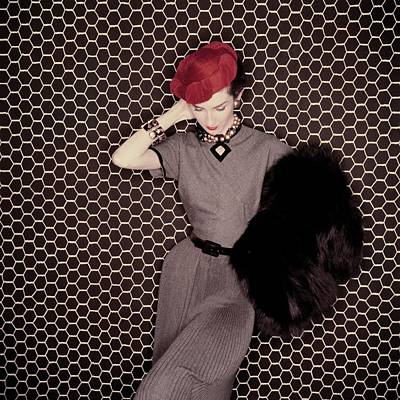Fashion Photograph - A Model In A Grey Dress And Red Hat by Clifford Coffin