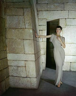 Ancient Culture Photograph - A Model In A Omar Kiam Dress by John Rawlings