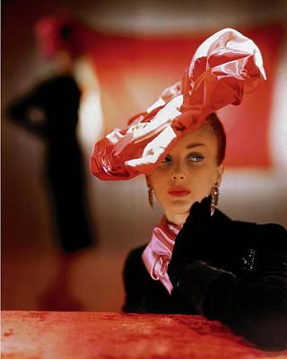 Black Jacket Photograph - A Model In A Suzanne Et Roger Hat by John Rawlings