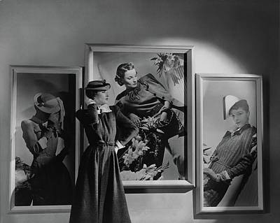 Photograph - A Model In Front Of Photographs by Horst P. Horst
