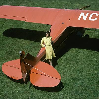 Fashion Photograph - A Model Leaning On An Airplane by Toni Frissell