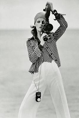 Black And White Photograph - A Model Looking Through A Beaulieu Camera Wearing by Gianni Penati