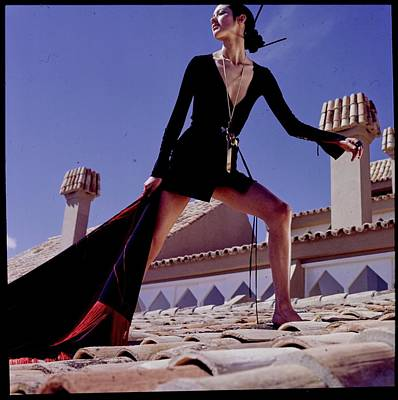 Gold Necklace Photograph - A Model On A Rooftop In A Dress By Paraphernalia by Henry Clarke