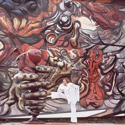 Trio Photograph - A Model Posing In Front Of A Mural by Henry Clarke