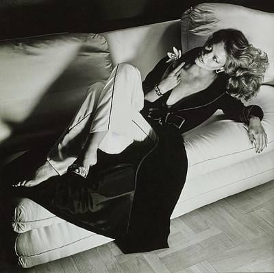 Cross Legged Photograph - A Model Reclines On A Sofa Wearing Fernando by Chris von Wangenheim