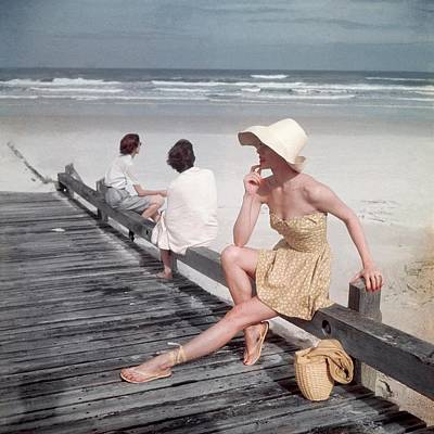 Bathing Suit Photograph - A Model Sitting On A Ramp by Serge Balkin