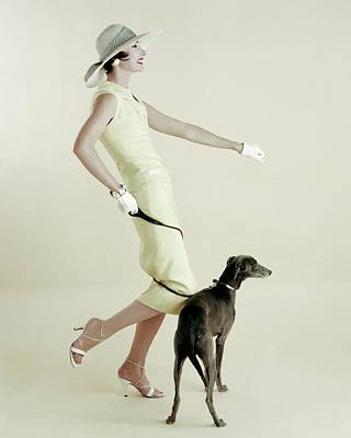 1950s Fashion Photograph - A Model Walking A Dog by Richard Rutledge