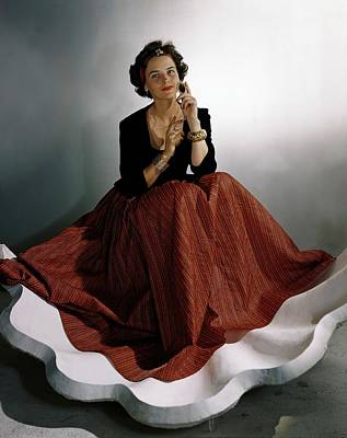 Photograph - A Model Wearing A Billowing Red Skirt by Horst P. Horst