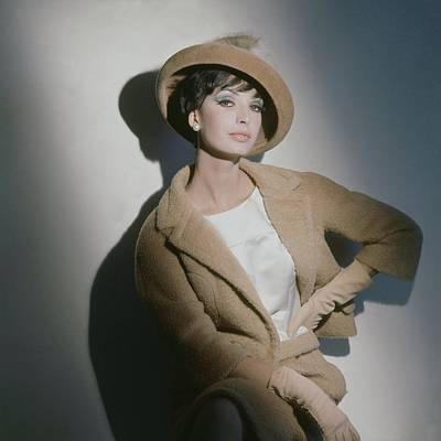 Earrings Photograph - A Model Wearing A Camel Wool Suit by Horst P. Horst