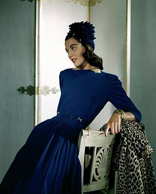 Blue Bracelet Photograph - A Model Wearing A Cap And Dress by Horst P. Horst