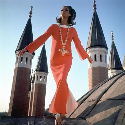 Middle East Photograph - A Model Wearing A Christian Dior Dress by Henry Clarke