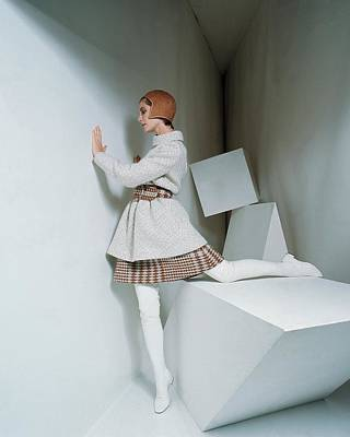 Photograph - A Model Wearing A Coat And Plaid Skirt by David Mccabe
