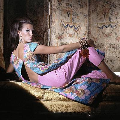 A Model Wearing A Colorful Top And Pants Art Print