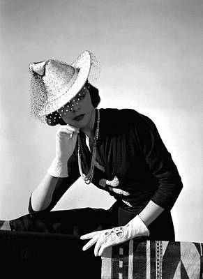 Photograph - A Model Wearing A Crepe Dress And Hat by Horst P. Horst
