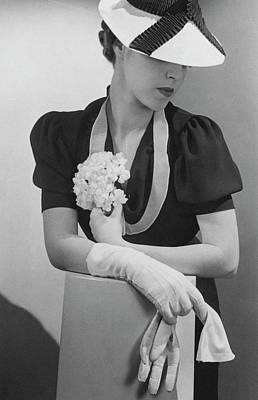 Photograph - A Model Wearing A Crepe Dress And Straw Hat by Lusha Nelson