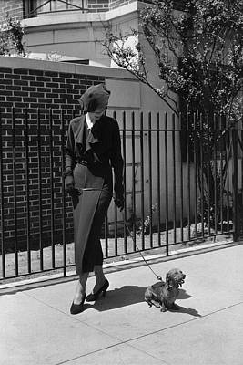 A Model Wearing A Dress Walking A Dog Art Print by Lusha Nelson