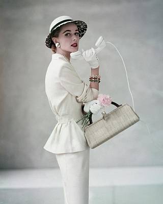 Jewelry Bag Photograph - A Model Wearing A Handmacher Suit by Francesco Scavullo