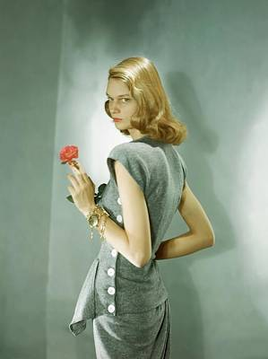 Button Down Shirt Photograph - A Model Wearing A Matching Shirt And Skirt by Horst P. Horst