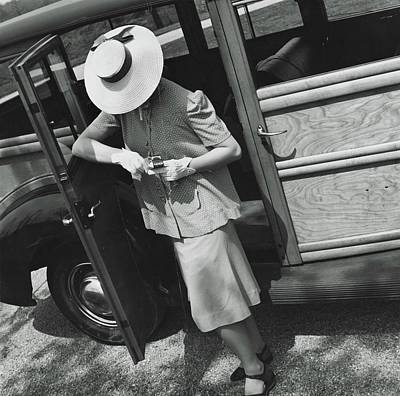Car Doors Photograph - A Model Wearing A Maternity Suit by Toni Frissell