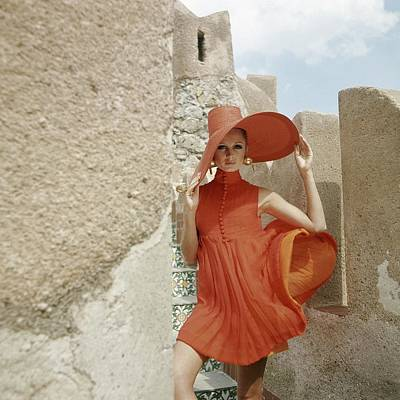 Headgear Photograph - A Model Wearing A Orange Dress by Henry Clarke