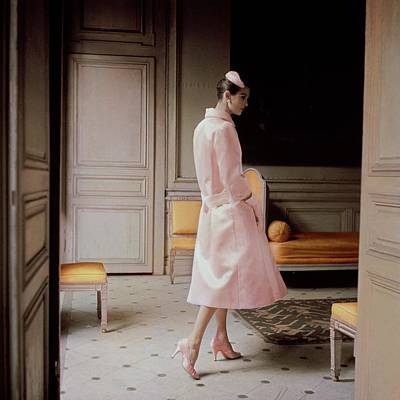 1955 Photograph - A Model Wearing A Pink Coat by Karen Radkai
