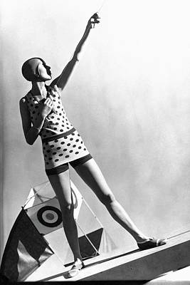 Bathing Suit Photograph - A Model Wearing A Polka Dot Swimsuit by George Hoyningen-Huene
