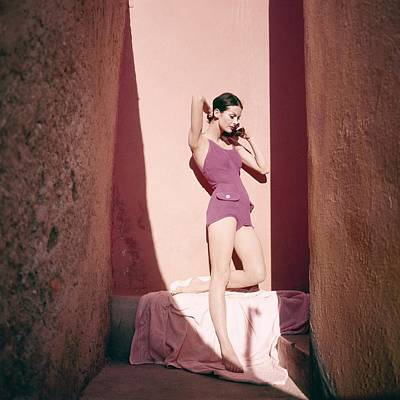 Bathing Suit Photograph - A Model Wearing A Purple Bathing Suit by Tom Palumbo
