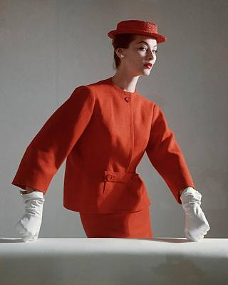 Photograph - A Model Wearing A Red Suit With Matching Hat by Horst P. Horst