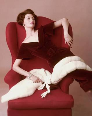 1950s Fashion Photograph - A Model Wearing A Red Velvet Dress by John Rawlings