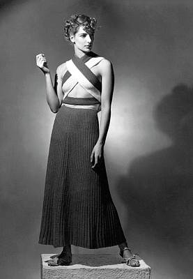Knitted Dress Photograph - A Model Wearing A Ribbed Knit Dress by Horst P. Horst