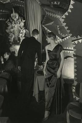 Young Man Photograph - A Model Wearing A Schiaparelli Dress by Donald Honeyman