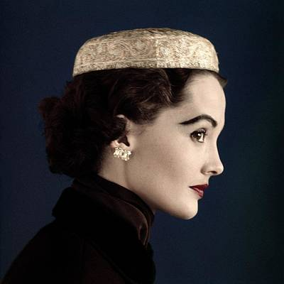 Silver Earrings Photograph - A Model Wearing A Siam Hat by Horst P. Horst
