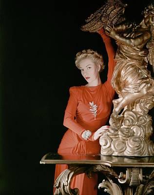 Earrings Photograph - A Model Wearing A Silk Jersey Dress by Horst P. Horst