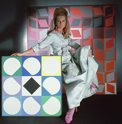 A Model Wearing A Stella Robe With Vasarely Art Print by Horst P. Horst
