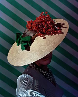 1930s Fashion Photograph - A Model Wearing A Straw Hat by Andre Durst