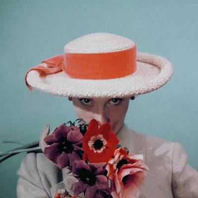 A Model Wearing A Straw Hat Art Print by Clifford Coffin