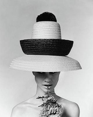 Look Away Photograph - A Model Wearing A Sun Hat by Karen Radkai