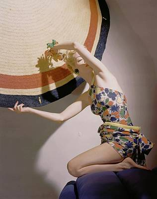 1930s Fashion Photograph - A Model Wearing A Swimsuit And Holding An by Horst P. Horst