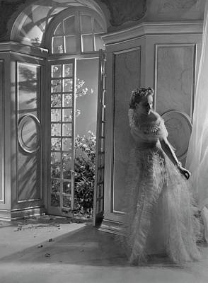 French Doors Photograph - A Model Wearing A Tulle Dress by Horst P. Horst