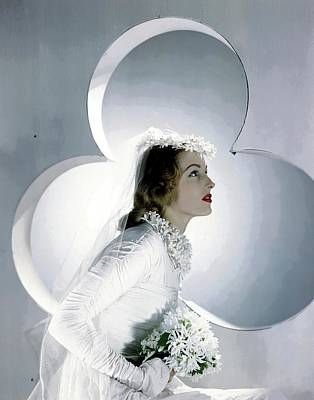 Bouquet Photograph - A Model Wearing A Wedding Gown by Horst P. Horst