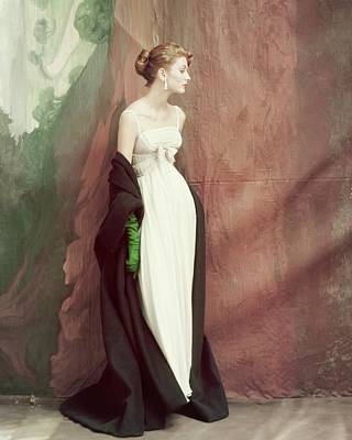 Photograph - A Model Wearing A White Dress by John Rawlings